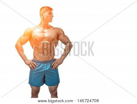 Strong Athletic Man showing muscular body and sixpack abs isolated on white background. with sun flare