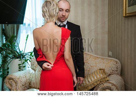 Man Unzips Female Dress