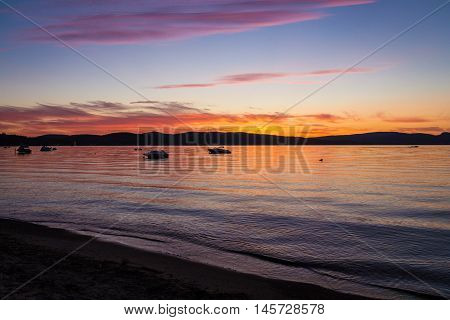 Colorful sunset over lake and mountain in St-Gabriel-de-Brandon Maskinonge Lake Quebec Canada in september