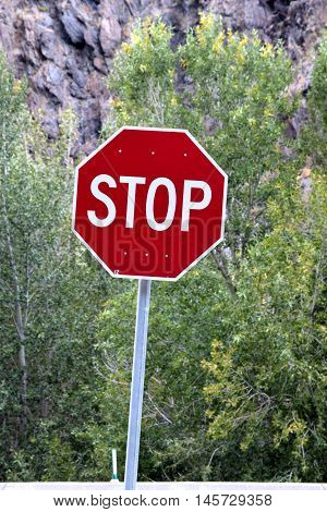 photo of stop sign in the mountain road