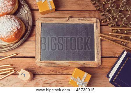 Jewish holiday Hanukkah celebration background with chalkboard