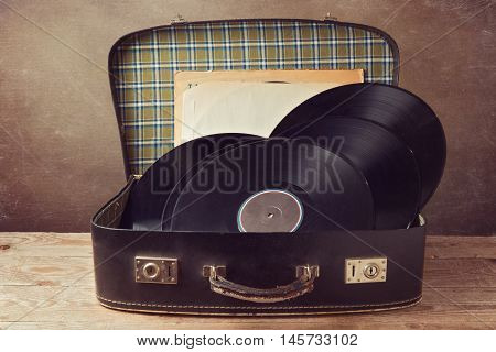 Vintage suitcase with old music vinyl records