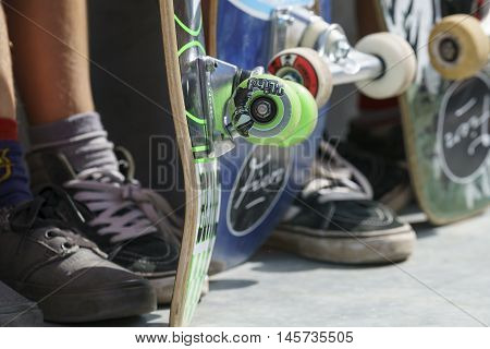 DORDRECHT NETHERLANDS - 3 SEPTEMBER 2016: Close-up of skateboard wheels and feet as teens hang out at the official opening of the new skateboard park in Dordrecht.