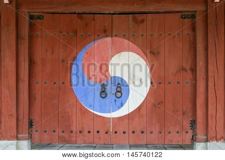 Korean traditional wooden gate with yin yang symbol