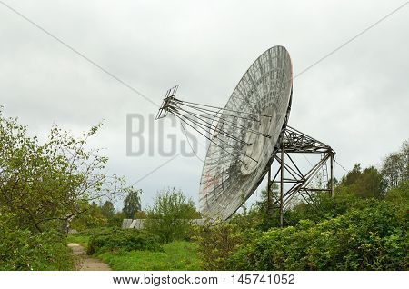 Old radio telescope on the territory of observatorii fit only for scrap.
