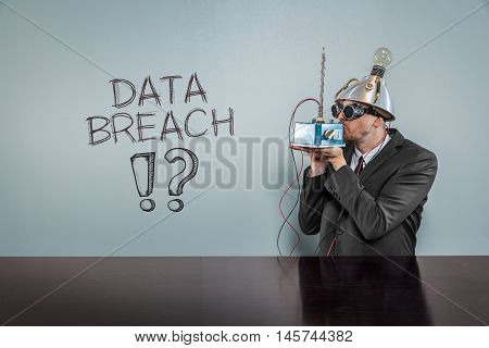 Data breach text with vintage businessman kissing machine