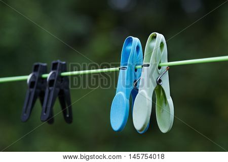 Clothespegs of various color on the rope