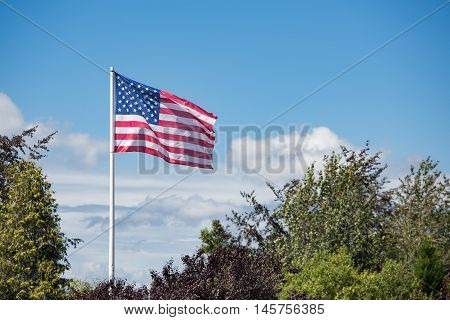 American flag Stars and Stripes at Bastogne WW2 Memorial in Belgian Ardennes