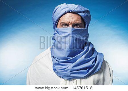 Berber Man Wearing Blue Turban With White Robe. Studio Shot.