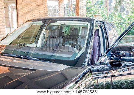 four-wheel drive car in black with the door open