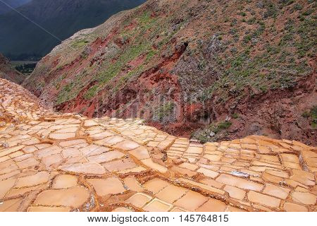 Salinas de Maras - salt evaporation ponds near town of Maras in Peru. These salt pans are in use since Inca times.