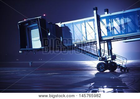 Airport gateway before plane arrival. Modern international airport at night.