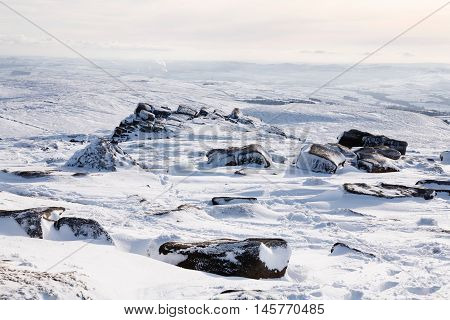 Snow covered mountains in winter in English countryside Peak District Derbyshire UK
