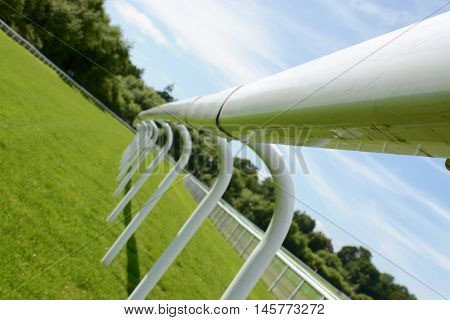 Fence at a horse race track on a sunny day