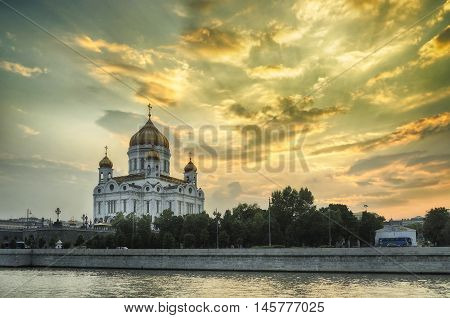 Moscow sunset view. Moscow landscape - Cathedral of Christ the Saviour and Patriarshy bridge in summer sunset in Moscow Russia. Summer view of Moscow architecture landmark. Moscow architecture view.