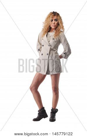 beautiful young curly hairs women posing with topcoat in studio