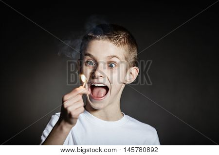 Excited Male Child Yelling With Flaming Match