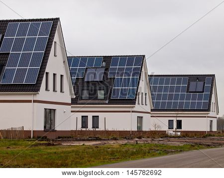 New Houses With Solar Panels In A Street