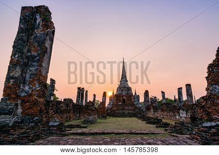 Ruins and pagoda ancient architecture of Wat Phra Si Sanphet old temple famous attractions during sunset at Phra Nakhon Si Ayutthaya Historical Park in Ayutthaya Province Thailand