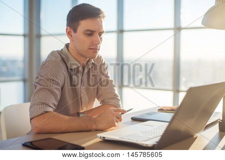 Man freelancer businessman working on laptop computer in office