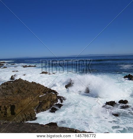 This is an image of the incoming tide and rocks at the Asilomar State Reserve in Pacific Grove, California.