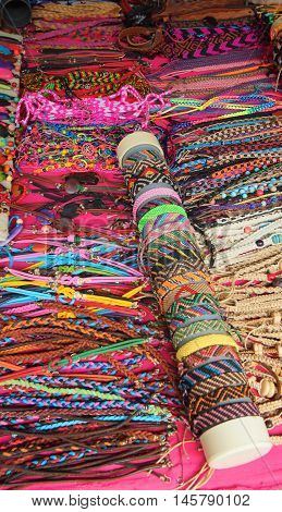 Banos de Agua Santa, Tungurahua / Ecuador - September 2 2016: Indian handmade bracelets sale at a craft store in the Pasaje Artesanal in the downtown of the city of Banos