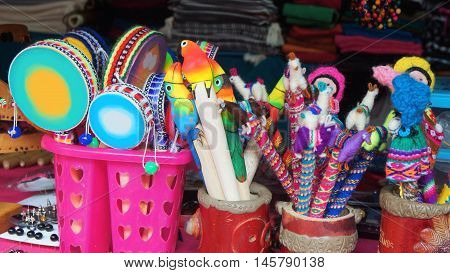 Banos de Agua Santa, Tungurahua / Ecuador - September 2 2016: crafts sale at a craft store in the Pasaje Artesanal in the downtown. Banos is located on the northern foothills of the Tungurahua volcano