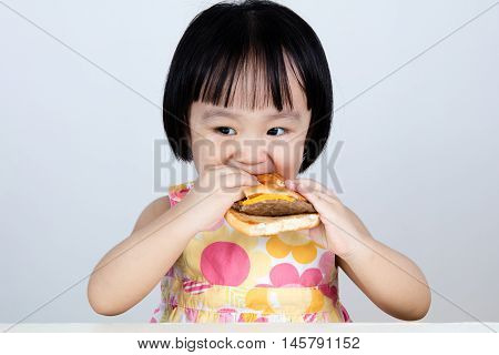 Asian Chinese Little Girl Eating Burger
