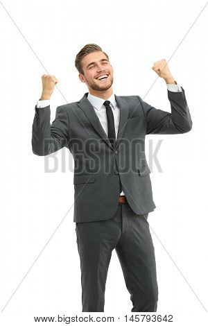 Lucky handsome businessman celebrating. Winner  laughing man