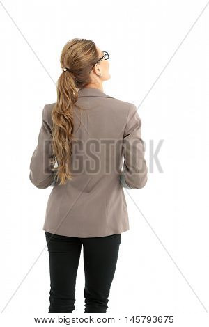 Full-length back side of businesswoman, isolated on white.