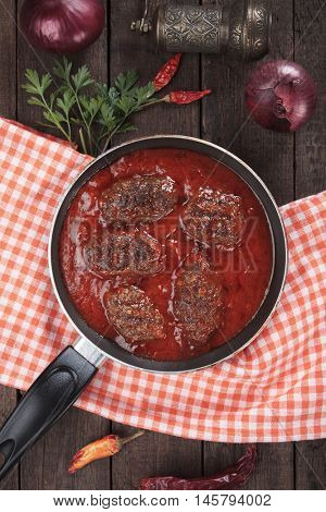 Kofta, oriental ground beef or lamb meatballs cooked in tomato sauce