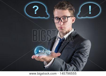 Young man in creative idea concept