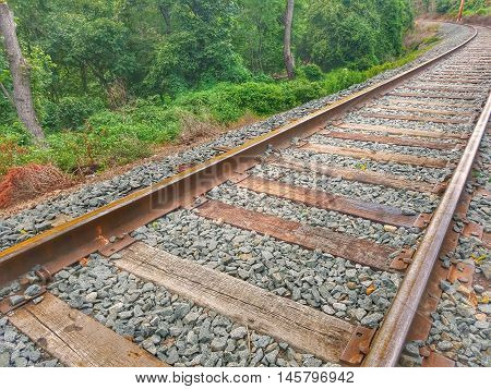 railroad tracks with the turn in the horizon