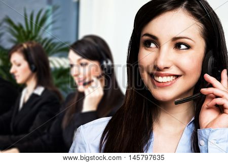 Portrait of a smiling customer representatives at work