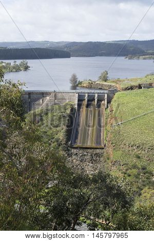 Concrete arch dam with ski-jump spillway of the Myponga Reservoir in Myponga South Australia. In portrait orientation.