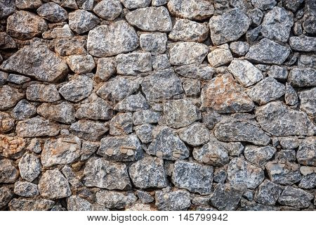 Mediterranean old rock wall background. Medieval design template or hisrtory art