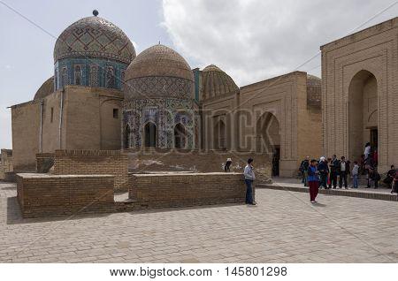 Samarkand, Uzbekistan - April 26, 2015: People in Shah-I-Zinda memorial complex necropolis in Samarkand Uzbekistan. UNESCO World Heritage