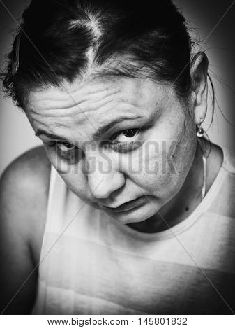 Portrait of a sick, sad, tired woman.  Black and white photo
