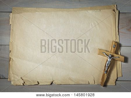 Catholic crucifix and old paper as a background for your text