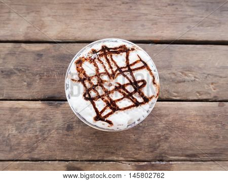 Coffee caramel frappe with whipped cream in a coffee shop.Top View