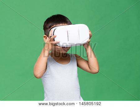 Asian little boy watching with VR