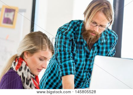 Two office workers at the desk