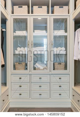 Large White Walk-in Closet With Shelves At Home