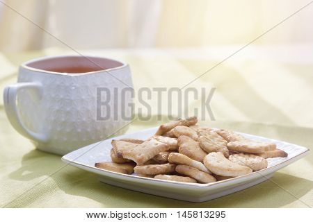 cup of tea and biscuits on the table