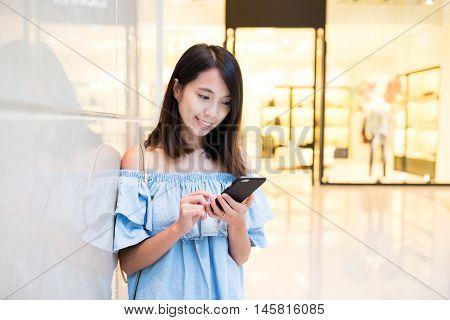 Woman sending sms on cellphone