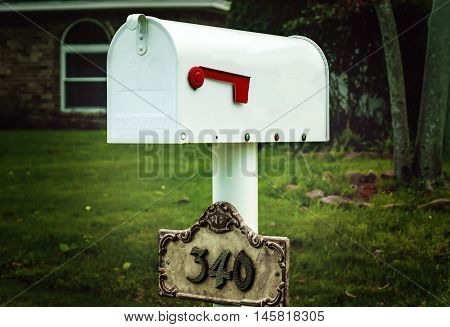 white mail box in front of the house.