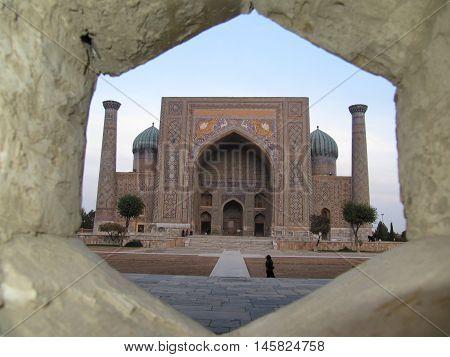 Perspective on the madrasah Sherdor in Registan Square in Samarkand city