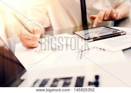 Young Business Woman Analyze Meeting Report Process.Online Startup Marketing Project.Account Manager Making Great Work Decisions Modern Office.Tablet Graphs Diagram Screen.Notebook Blurred Background