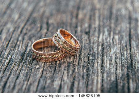 Wedding. Wedding card. Wedding flowers. Wedding rings and spring flowers. Wedding Rings. Wedding still life. Wedding card with wedding rings. Wedding rings on stone.