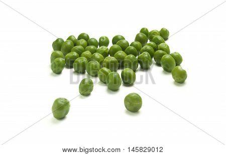 closeup of fresh green peas over white